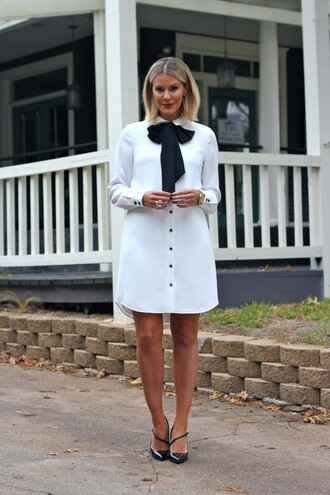 the courtney kerr blogger jewels white dress shirt black heels bows