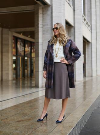 the classy cubicle blogger sunglasses winter coat midi skirt