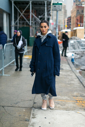 coat nyfw 2017 fashion week 2017 fashion week streetstyle navy navy coat blue long coat long coat joggers tracksuit athleisure sneakers pink sneakers hoodie grey hoodie sweatpants grey sweatpants