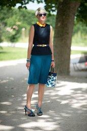 skirt,office outfits,pleated skirt,blue skirt,midi skirt,top,black top,gold belt,belt,sunglasses,blue sunglasses,bag,printed bag,sandals,blue sandals,stacked bracelets