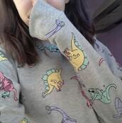 sweater,dinosaur,pastel,skateboard,ear buds,roller skates,sunglasses