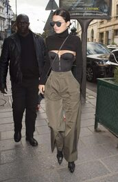 pants,bustier,kendall jenner,pumps,streetstyle,paris fashion week 2016,crop tops,model off-duty,boots,shoes