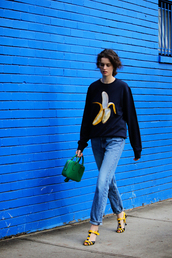 by chill,blogger,sweater,jeans,jewels,bag,shoes,graphic sweatshirt,crewneck,blue top,green bag,fall outfits,blue jeans,sandals,sandal heels,high heel sandals,yellow sandals,sweatshirt,printed sandals