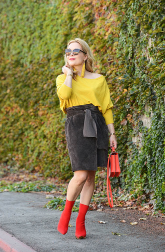 thehuntercollector blogger sweater skirt shoes bag jewels sunglasses fall outfits earrings boots red boots red bag sock boots suede skirt yellow sweater