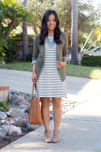 puttingmetogether blogger jewels mini dress stripes striped dress nude bag beige statement necklace green jacket suede boots ankle boots date outfit
