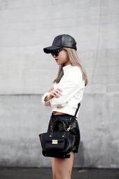la vagabonde dame,leather shorts,leather cap,black cap,white sweater,black leather bag,black bag,leather bag,outfit idea,dope,tortoise shell sunglasses,black baseball hat