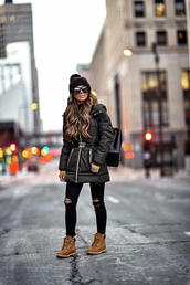 coat,tumblr,green coat,parka,denim,jeans,black jeans,ripped jeans,boots,brown boots,beanie,black beanie,sunglasses,backpack,black backpack
