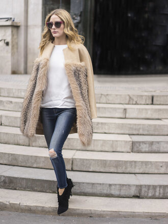 coat fur olivia palermo blogger fashion week 2016 streetstyle paris fashion week 2016 jeans big fur coat cat eye sunglasses red sunglasses white top top ripped jeans blue jeans boots black boots fringe shoes