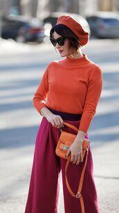 hat,maroon beret,orange shirt,orange handbag,flare,sunglasses