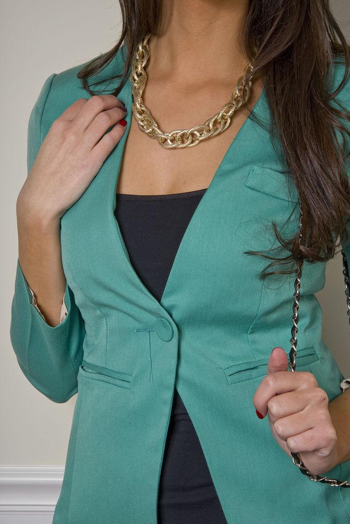 Green blazer with polka cuff accent