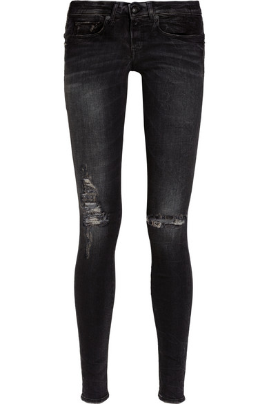 Black distressed low rise skinny jeans