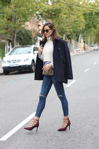 lady addict blogger coat bag sweater shirt jeans shoes sunglasses jewels white cable knit sweater white sweater cropped sweater black coat skinny jeans blue jeans leopard print