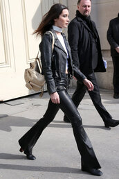 jacket,pants,leather,leather pants,biker jacket,streetstyle,fashion week 2016,paris fashion week 2016,bella hadid,model off-duty,lace up pants