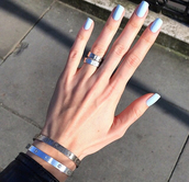 jewels,cartier,gold,silver,bracelets,ring,nail polish,jewelry,stacked bracelets,stacked ring,silver jewelry,silver ring