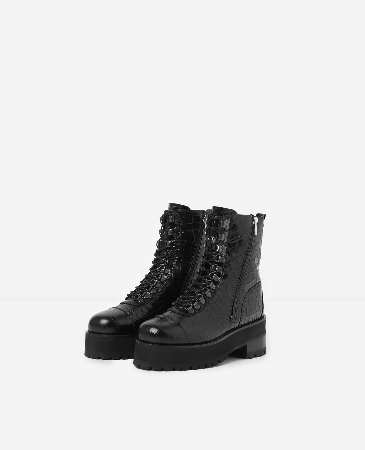 Black leather lace-up boots w/ notched soles