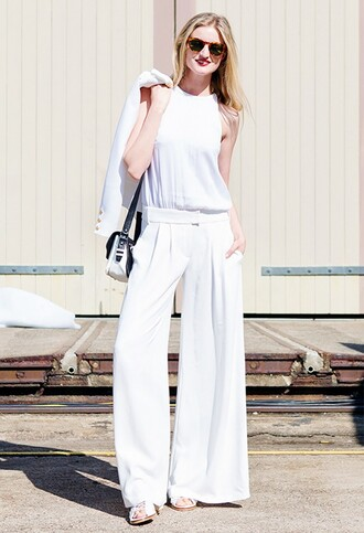 pants white top white pleated pants black and white purse sunglasses blogger