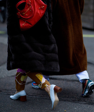 shoes tumblr white shoes mid heel pumps thick heel pants printed pants coat black coat fur coat black fur coat black long coat long coat sneakers bag red bag fashion week 2017 streetstyle