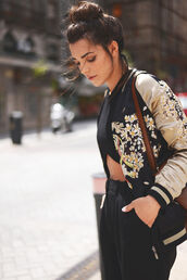 jacket,letterman jacket,black and gold letterman,floral letterman,floral black and gold jacket,floral black & gold letterman,floral letterman jacket,black and gold letterman jacket,bomber jacket,japanese,japanese print,overwear,black,crop tops,satin bomber,black bomber jacket,embroidered jacket,black pants,black crop top,top knot bun,crossbody bag,brown crossbody bag,shoulder bag,gold,floral jacket,printed jacket,cute,baseball jacket