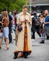 coat,trench coat,long coat,asymmetrical dress,floral dress,printed dress,ruffle dress,handbag,boots