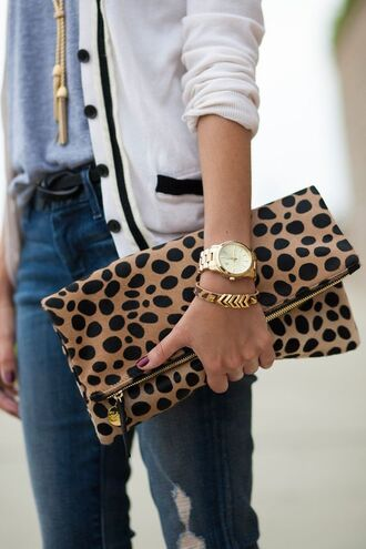 jewels boyfriend watch ripped jeans grey t-shirt fold clutch gold boyfriend watch white cardigan animal print clutch gold bracelet zipper clutch gold watch