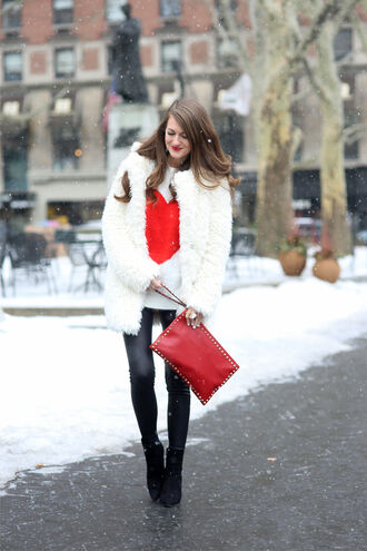 southern curls and pearls blogger sweater red bag heart fuzzy coat leather leggings heart sweater white fur coat fur coat white sweater leggings black leggings pouch red pouch high heels boots black boots white fluffy coat pointed toe boots cold weather outfit