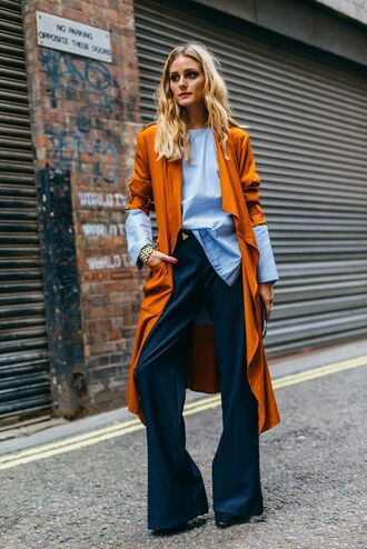 coat streetstyle london fashion week 2016 shirt blouse blogger olivia palermo trench coat work outfits tumblr pants blue pants flare pants wide-leg pants blue shirt mustard mustard coat