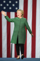 coat,green,pants,hillary clinton,first lady outfits,fall coat