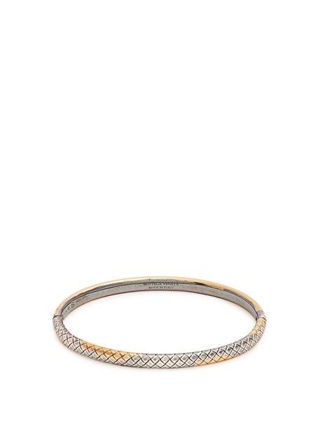 Bottega Veneta gold jewels