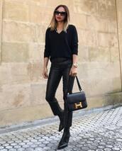 pants,skinny pants,black pants,leather pants,black blouse,sock boots,handbag,sunglasses