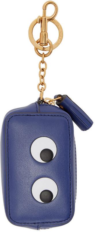 eyes purse blue bag