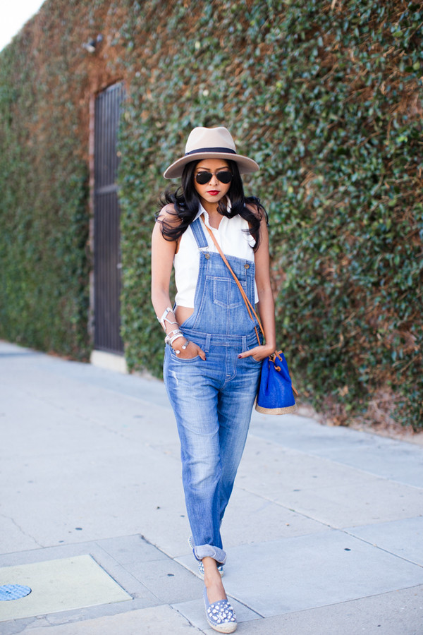 walk in wonderland blogger denim overalls sun hat spring outfits white crop tops slip on shoes blue bag printed slippers overalls white top sleeveless top felt hat hat bag bucket bag sunglasses aviator sunglasses crop tops