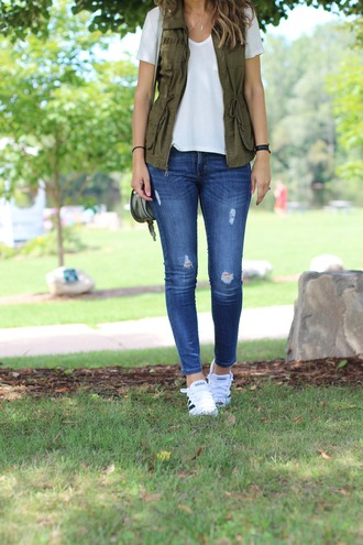 lilly style blogger jacket t-shirt jeans shoes jewels sunglasses sleeveless army green jacket white top skinny jeans white sneakers