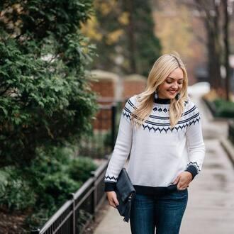 sweater environmentally friendly white sweater denim jeans blue jeans bag black bag tassel blonde hair earrings accessories accessory eco friendly