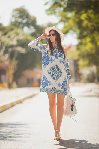 the bow-tie blogger dress patterned dress blue and white cut off shoulder