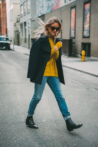 the fashion guitar blogger sweater jeans shoes sunglasses jacket tumblr black jacket sweatshirt yellow yellow top denim blue jeans cuffed jeans boots black boots ankle boots mid heel boots