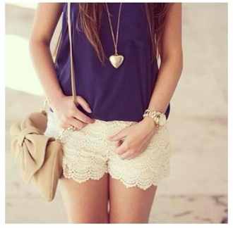 heart pendant gold necklace crochet shorts off-white bow shoulder bag beige bag gold watch cute date outfit lace shorts shorts lace dark blue top necklace summer