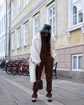 hat,black hat,pants,black high heels,brown bag,white fur coat,brown sweater
