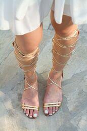 shoes,sandals,flat sandals,gladiators,knee high gladiator sandals,gold sandals,gold flat sandals,dress,white dress,nails,Gold low heel sandals