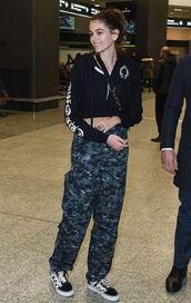 pants,kaia gerber,model off-duty,milan fashion week 2018,fashion week,hoodie,camouflage,camo pants,jacket
