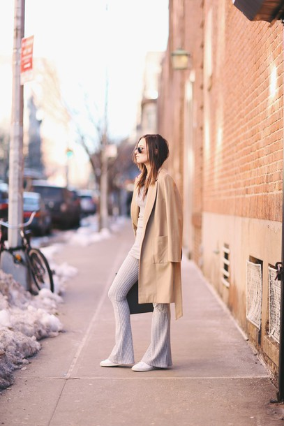we wore what blogger camel coat flare pants