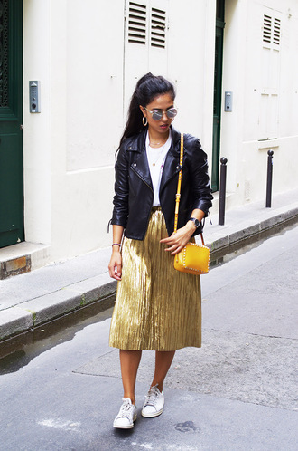 skirt sunglasses white t-shirt black leather jacket gold pleated skirt white sneakers yellow bag blogger