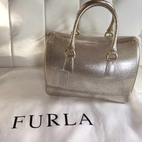 30% off Furla Handbags - Furla Gold Glitter Candy Bag Gorgeous and Complete from Candy's closet on Poshmark