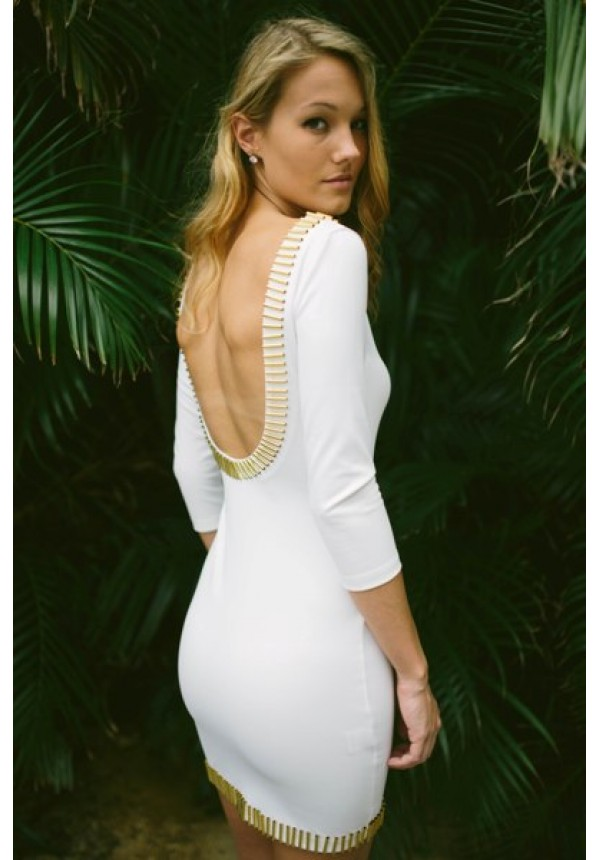 Exclusively e's! double knit white bodycon dress featuring a gold bar trim and plunging scoop back.