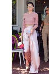 pants,pastel pink,kendall and kylie jenner,kendall jenner,kardashians,pink,sexy,elegant,unique style,style,celebrity,celebrity style,crop tops,aviator sunglasses,mirrored sunglasses,ankle strap heels,pink sweater,cropped sweater,silk,wide-leg pants,suede,kylie jenner,keeping up with the kardashians