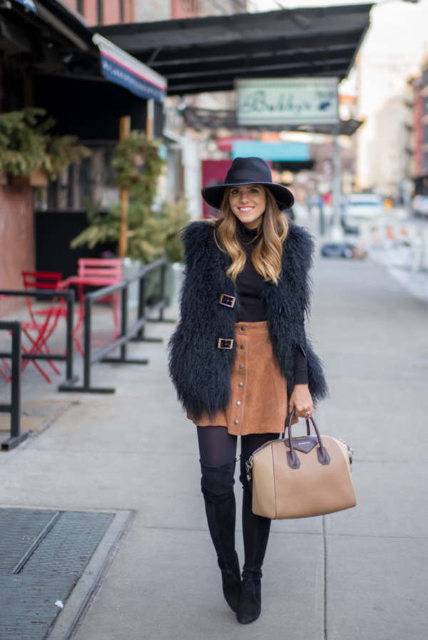 gal meets glam blogger jacket skirt tights shoes bag gloves hat black fur vest black turtleneck top turtleneck suede skirt button up button up skirt felt hat opaque tights thigh high boots over the knee boots