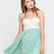 Buy motel annali strapless cream bustier dress in soft green at motel rocks