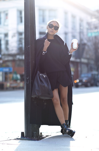 the haute pursuit blogger skorts maxi bag leather bag long coat black winter outfits sweater coat shoes jewels
