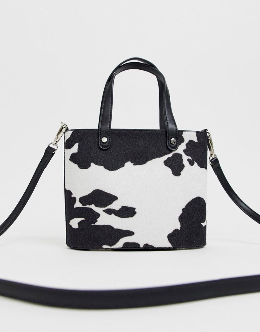 ASOS DESIGN bucket bag in cow print