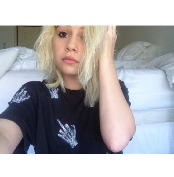 skull bones bea miller t-shirt bea middle finger skull hands blonde hair