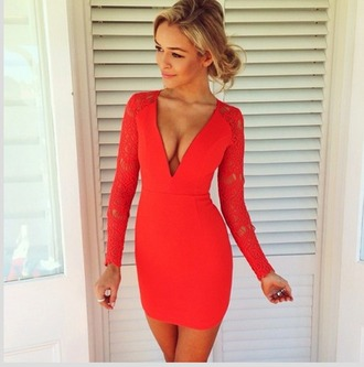 dress clothes orange colorful v neck white background short dress short long sleeves pretty gorgeous formal prom clubwear vibrant bright older beautiful outfit cleveage red blonde hair make-up done up tight bodycon contouring shape